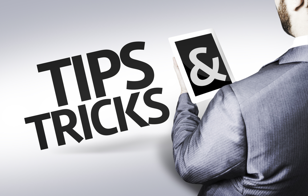 Business man with the text Tips & Tricks in a concept image
