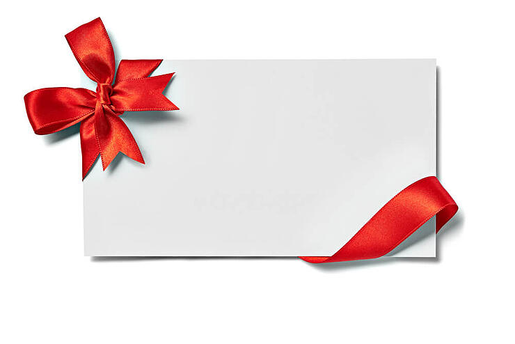 close up of a note card with ribbon bow on white background tiny